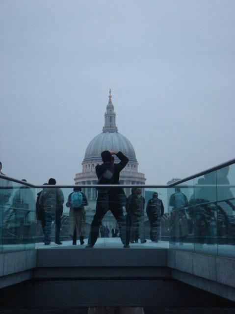 A picture of a guy taking a picture of St. Paul's